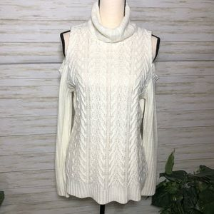 Knit sweater with cold shoulder